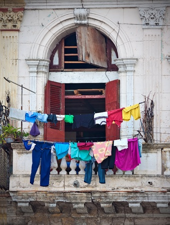 Balcony with clothes in an old building in Havana photo