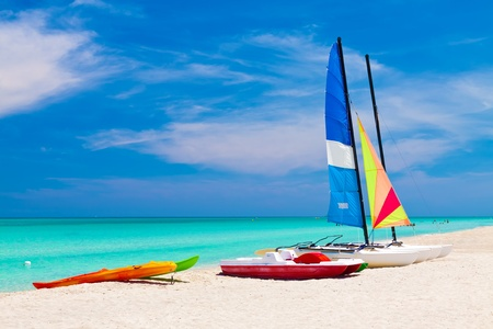 tourist resort: Sailing catamarans and water bikes in the beautiful beach of Varadero in Cuba Stock Photo