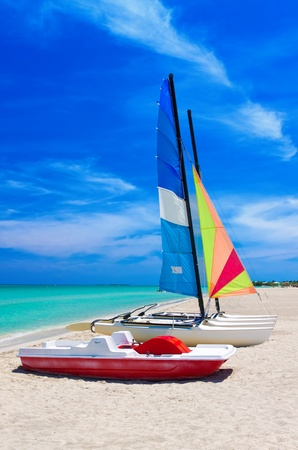 Catamaran and water bikes landed on the beautiful beach of Varadero in Cuba