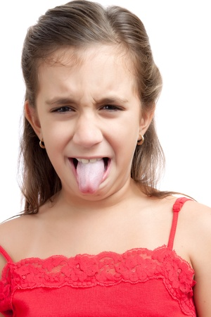 grotesque: Hispanic girl making funny faces isolated on white