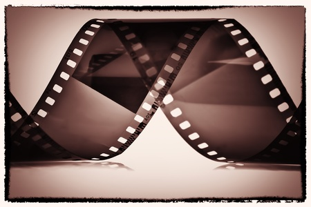 35 mm: Photography film reel on a sepia vignetted background
