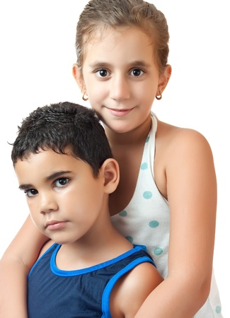 cousin: Latin girl hugging her younger brother isolated on a white background