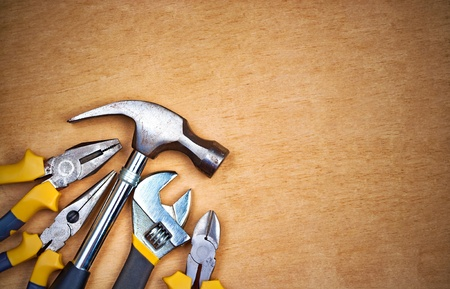 carpenter tools: Set of tools over a wood panel with space for text Stock Photo