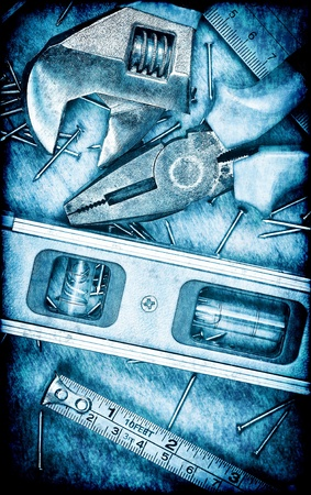 Metallic blue toned set of tools with a grunge look photo