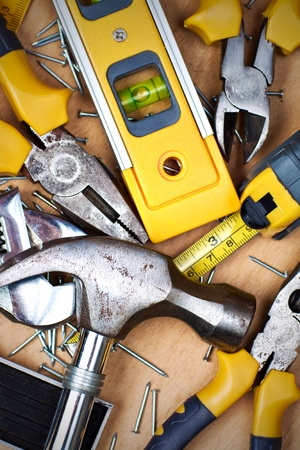 carpentry tools: Set of tools over a wood panel
