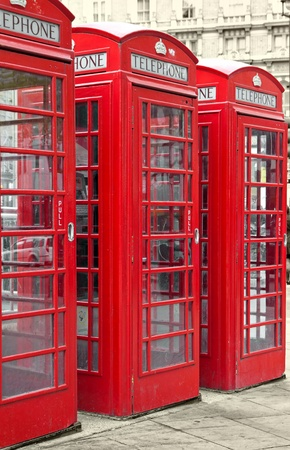 Row of three typical London phone booths with a desaturated background  photo