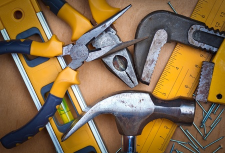 Set of tools over a wood panel photo