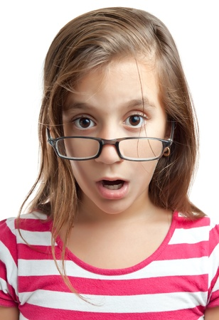 surprised kid: Portrait of a cute latin girl with glasses and a surprised look isolated on a white background