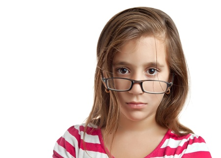 reflexive: Portrait of a small latin girl with glasses isolated on a white background Stock Photo
