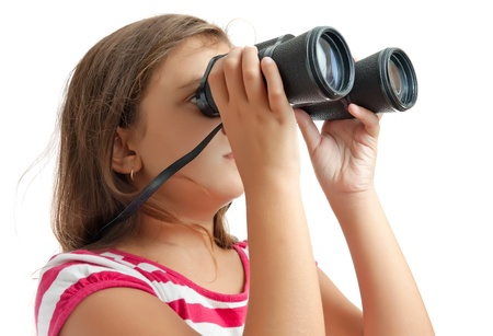 Small latin girl looking through a pair of binoculars isolated on a white background photo
