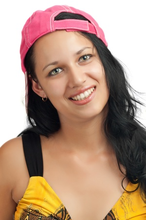 backward: Portrait of a young latin girl with beautiful green eyes wearing a backwards baseball cap isolated on a white background