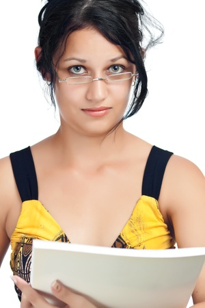 Beautiful hispanic student wearing glasses and holding a book isolated on a white background photo