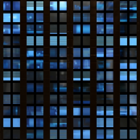 Seamless texture resembling illuminated windows in a building at night photo