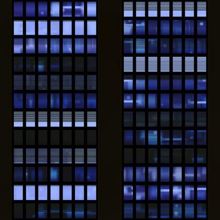 Seamless texture resembling windows of a modern skyscraper illuminated at night