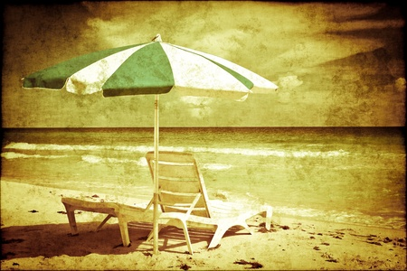 paper umbrella: Vintage image of an umbrella and beds on a beach