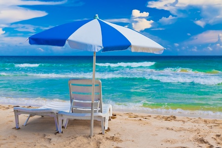 Chair and umbrella in the cuban beach of Vardero photo