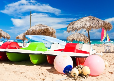 thatched: Water bikes and kayaks in a cuban beach