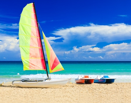 Catamaran and water bikes at the cuban beach of Varadero photo