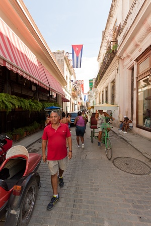 Street adorned with cuban flags in Old Havana Stock Photo - 11109405