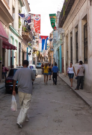 Street adorned with cuban flags in Old Havana