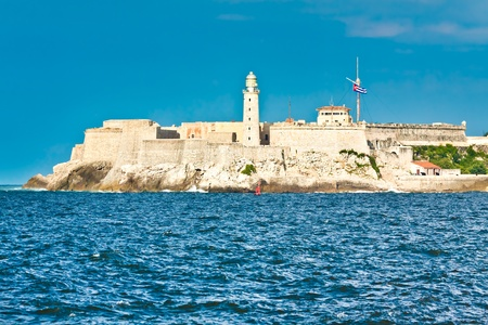 The fortress and lighthouse of El Morro in the entrance of the bay of Havana photo