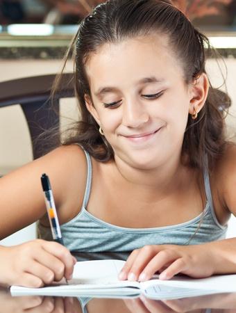 kids writing: Young latin girl working on her homework