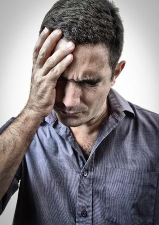 worried man: Grunge image of a man in pain