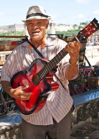HAVANA-OCTOBER 20:Musician playing for tourists October 20,2011 in Havana.Very famous through the world,the cuban music is an attraction for the more than 2 million people who visit cuba every year