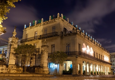 Restored spanish palace in Old Havana illuminated at night