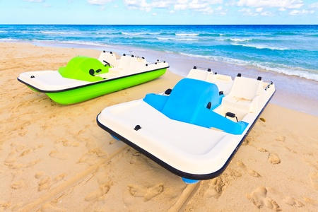 Colorful water bikes on a beautiful tropical beach photo