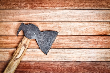 ax: Ax over a wooden boards background Stock Photo