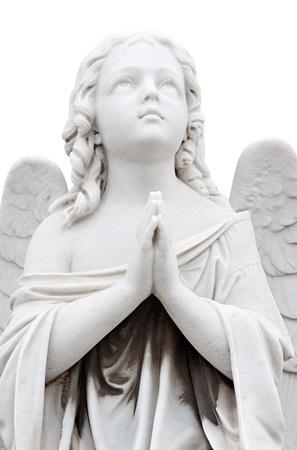 захоронение: Статуя ангела красивая молитва ребенка, изолированных на белом