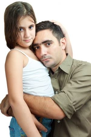 Young latin father hugging his daughter isolated on a white background photo
