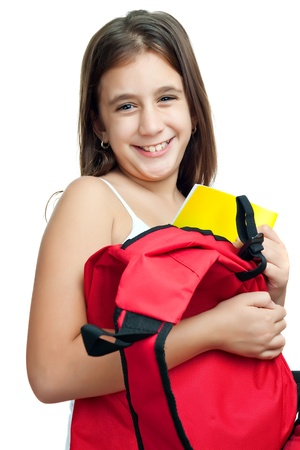 latina girl: Cute girl taking her textbook out of a bright red backpack isolated on a white background
