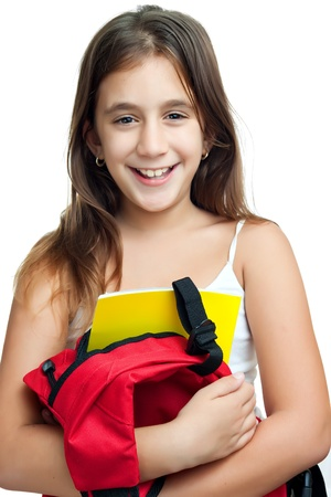 Cute girl carrying her school backpack with textbooks isolated on a white background photo