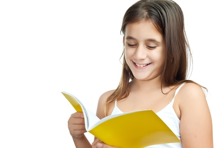 portrait of a cute girl reading isolated on a white background with space for text Stock Photo - 11874165