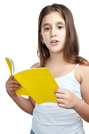 Vertical portrait of a cute girl reading isolated on a white background Stock Photo - 11874695