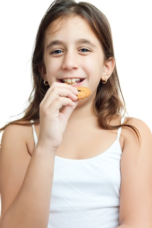 Beautiful latin girl eating homemade chocolate chips cookies isolated on white photo