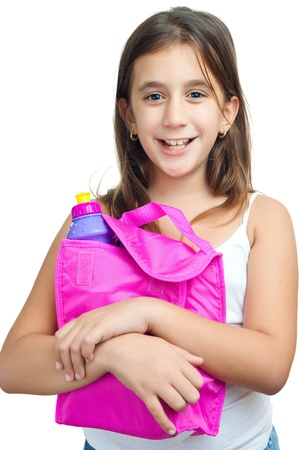 Cute  girl with a colorful lunch bag isolated on a white background photo