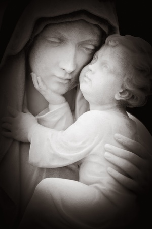 Beautiful black and white imahe of tlhe virgin Mary and the baby Jesus photo