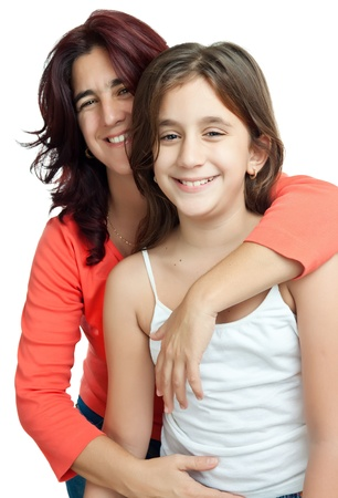 Young latin mother hugging her daughter  isolated on a white background Stock Photo - 11874741