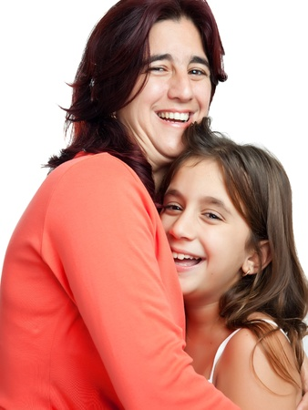 Young latin mother hugging her daughter  isolated on a white background Stock Photo - 11874759