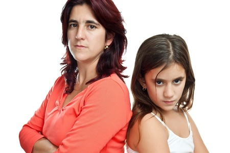 Young latin mother and her daughter mad at each other isolated on white Stock Photo - 11874763