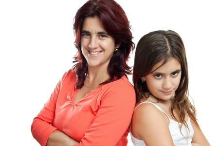 Young latin mother and her daughter  istanding back to back and smiling isolated on a white background Stock Photo - 11874758