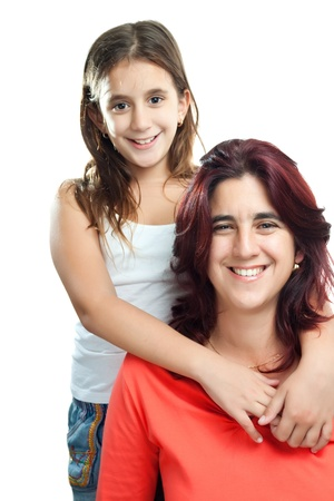 Adorable latin girl hugging her young mother isolated on a white background Stock Photo - 11874743
