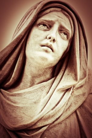 virgin girl: Vintage sepia image of a suffering religious woman statue Stock Photo