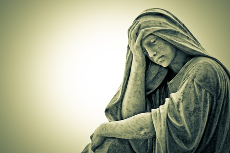 Vintage image of a suffering religious woman statue photo