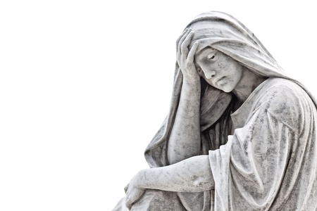 Marble sculpture of a very sad woman isolated on white photo