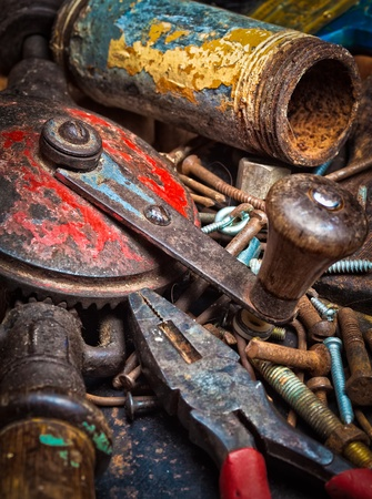 Grunge stack of old rusty manual tools photo
