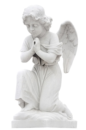 Statue of a child angel praying isolated on white with clipping path photo